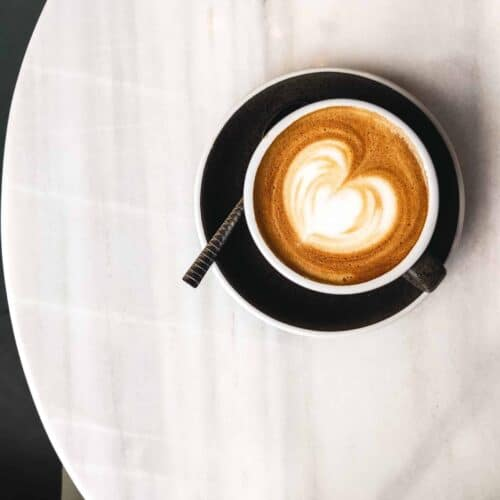 coffee-with-milk-with-hearty-latte-art-scaled
